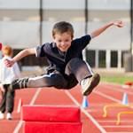 Kid jumping over hurdles